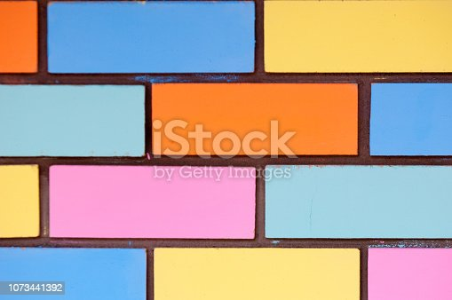 istock Texture background, pattern. Bricks painted with paint 1073441392