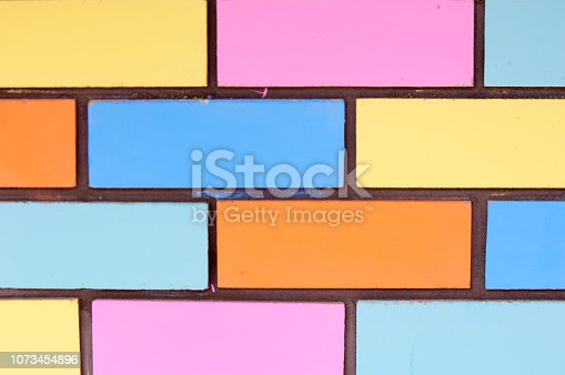 istock Texture background, pattern. Bricks painted with paint 1073454896