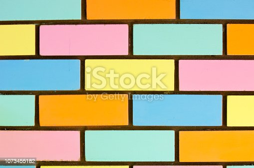 istock Texture background, pattern. Bricks painted with paint 1073455182