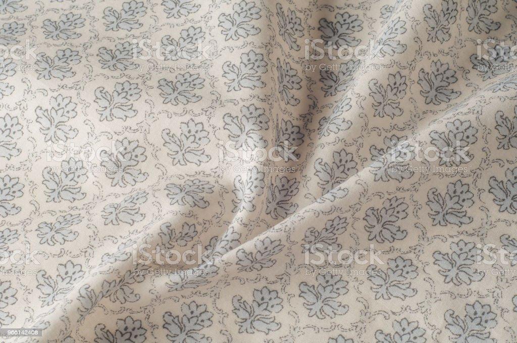 Textur Hintergrundmuster. Baumwolltuch ist grau. Flache Bauweise des grünen und grauen Blumen isoliert auf weißem Hintergrund. Blumen-Muster. - Lizenzfrei Abstrakt Stock-Foto