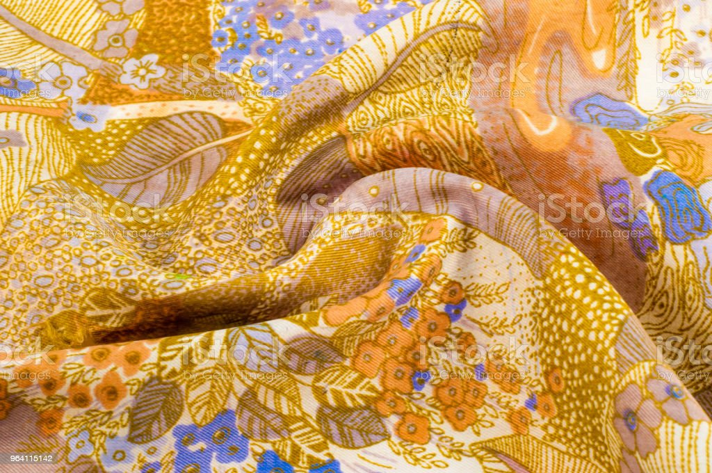 texture, background, pattern. Fabric silk abstract pattern. On beige fabric blue flowers, brown pattern A contemporary multipurpose upholstery and drapery fabric in colorful floral design of navy blue stock photo