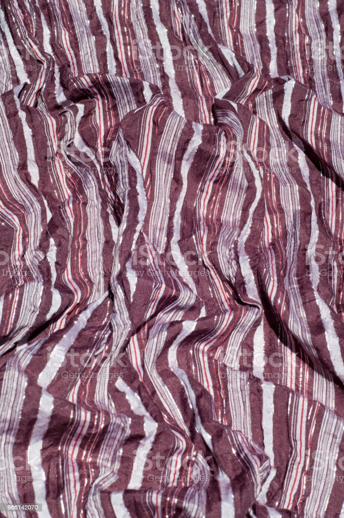 Texture, background, pattern. Female striped scarf, cloth striped brown, white, red with glitter - Foto stock royalty-free di Aruba