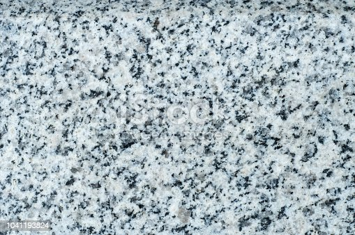 Texture, background, pattern. Granite stone. Padang Gray light gray granite with pronounced specks of black, quartz color, mined in Fujian province in the southeast of China.