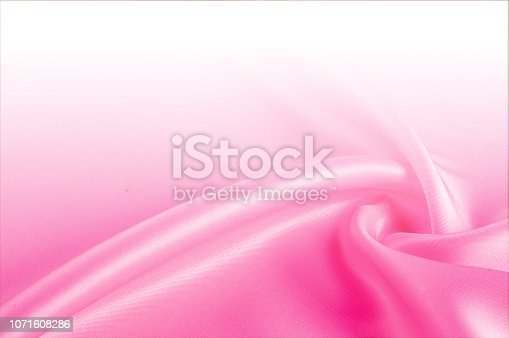 istock Texture, background, pattern. Light beige, pink shades of silk fabric, text space. Pink silk background based on natural texture 1071608286