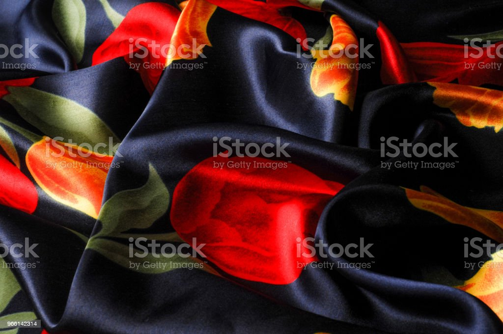 Texture, background, pattern. Silk fabric blue with tulips, yellow and red flowers. Cool Blue Watercolor Tulips Silky Vintage Fabric Yardage - Royalty-free Abstract Stock Photo