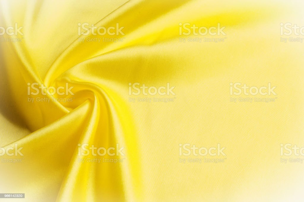 Texture background pattern. Silk fabric, yellow fabric. On a bla - Стоковые фото Абстрактный роялти-фри
