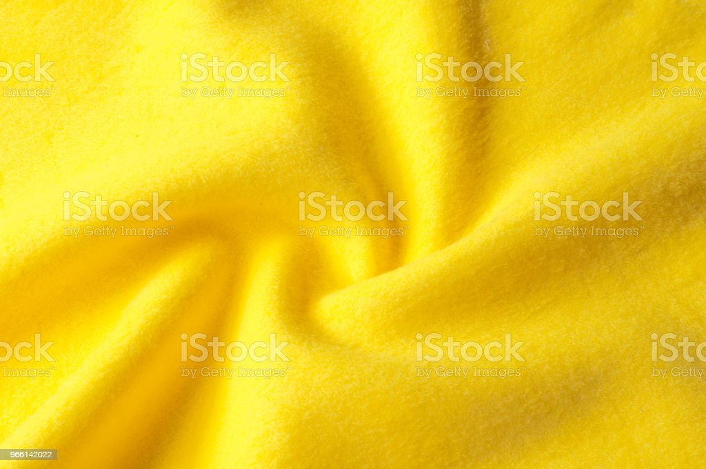 Texture background pattern. Woolen yellow fabric, cloth for a blanket, outer clothing.  Closeup horizontal fragment - Royalty-free Abstract Stock Photo