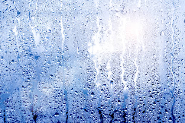 texture background wet drops of water dew on misted glass stock photo