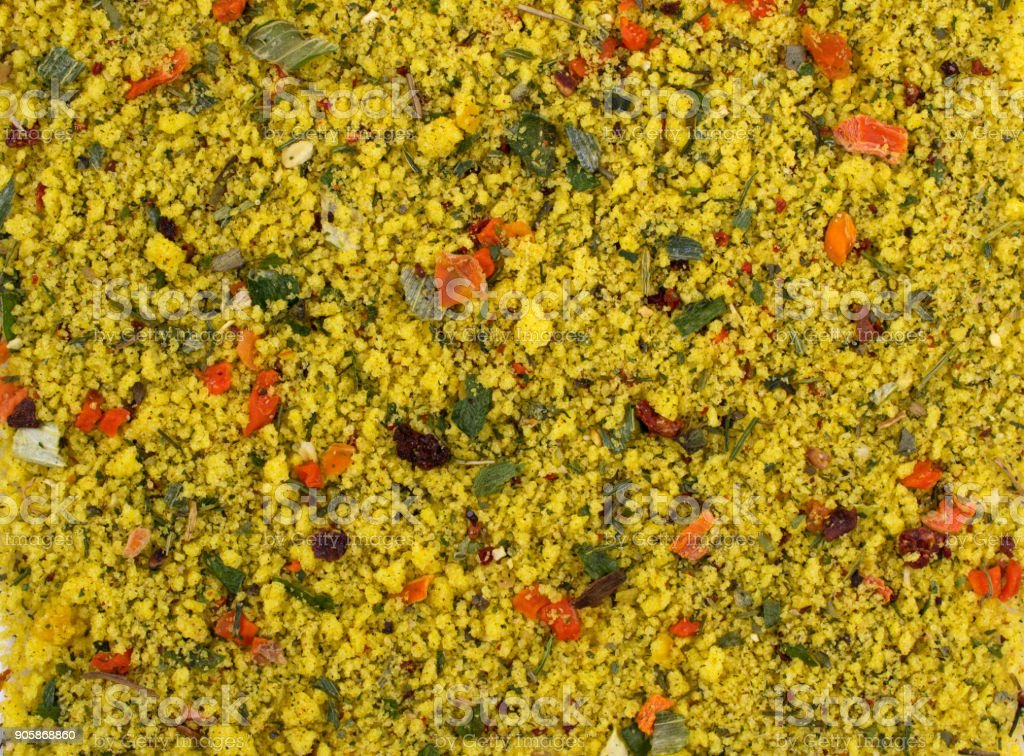 Texture background. Yellow spice mix. Spices consist dried dehydrated  vegetables carrot paprika onion garlic parsnip parsley tomatoes stock photo