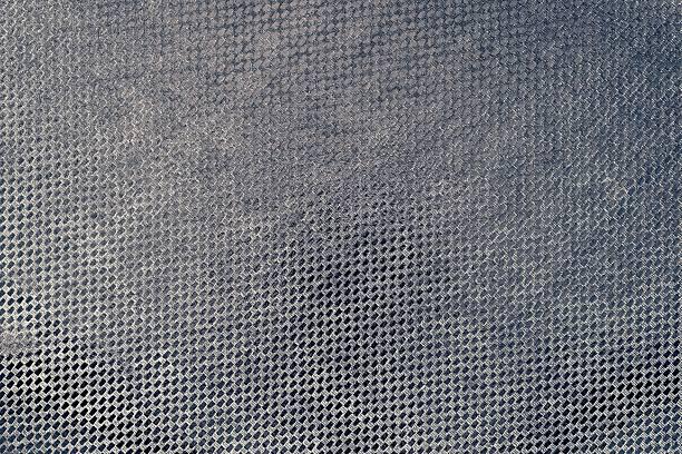 glänzende stoff textur schwarz lila farbe - kariertes hintergrundsbild stock-fotos und bilder