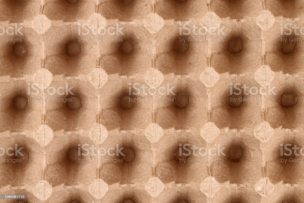 Texture cardboard egg. Top view of egg shell packaging. Empty...