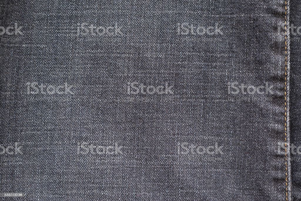 texture denim with the stitched seam of dark color stock photo