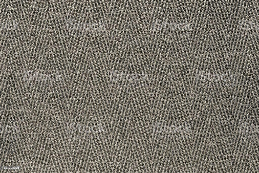 texture fabric a herringbone of beige color stock photo
