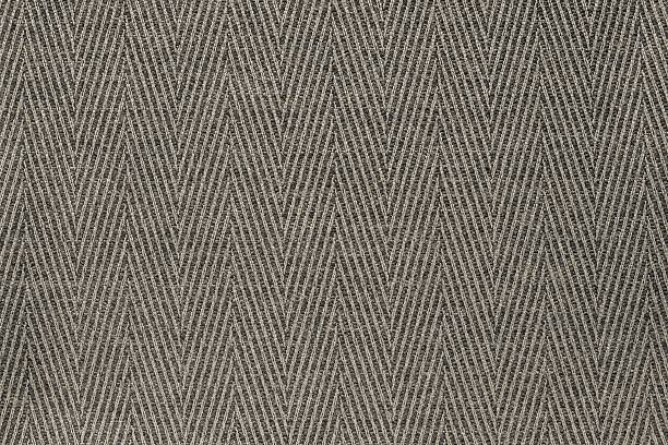 texture fabric a herringbone of beige color stock photo