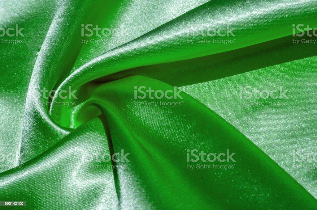 Textuur, stof, achtergrond. Abstracte achtergrond van luxe stof of vloeibare golven of golvende grunge kreukt zijde satijn textuur van materiaal fluweel of luxe kerst of elegante achtergrond. groen - Royalty-free Abstract Stockfoto