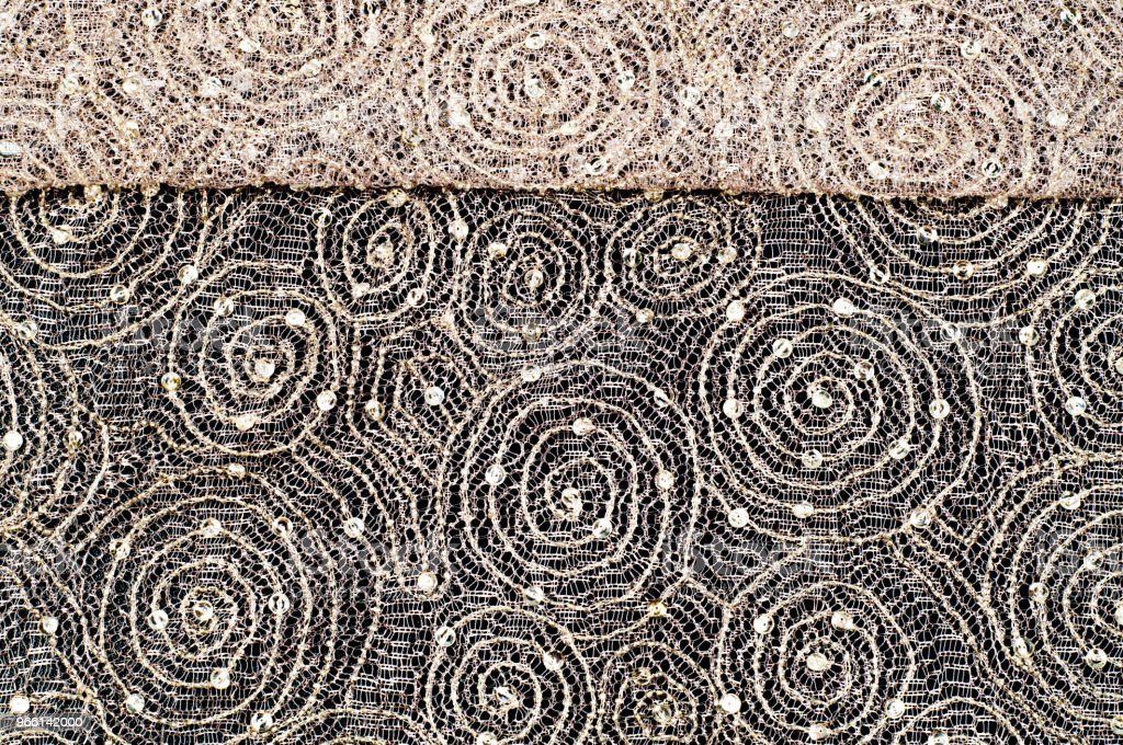 Texture, fabric, background. Lace fabric with a pattern of a circle, with a thread of gold thread - Royalty-free Abstract Stock Photo