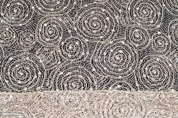 Textur Tyg Bakgrund Spets Tyg Med Mönster Av En Cirkel Med En Tråd Av Guldtråd-foton och fler bilder på Abstrakt