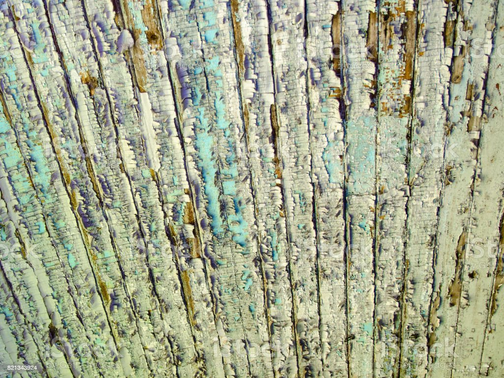 Texture. Flaky paint on ceiling of old wagon in train cemetery stock photo
