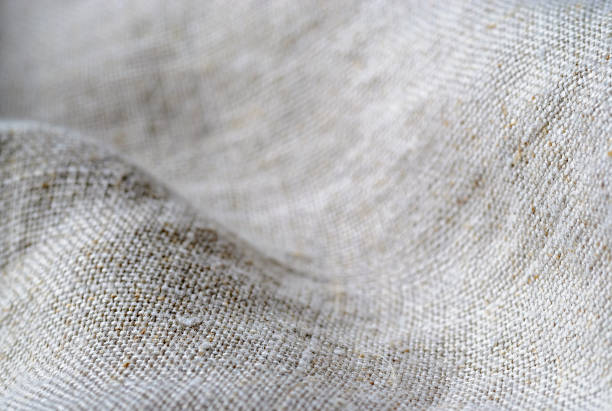 Texture if natural linen fabric draped in waves stock photo