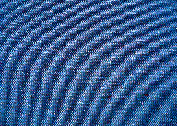 texture of a blue woven synthetic waterproof fabric - nylon texture stock pictures, royalty-free photos & images