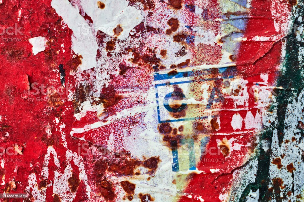 Texture of a bright wall with ruptures of posters and advertising....
