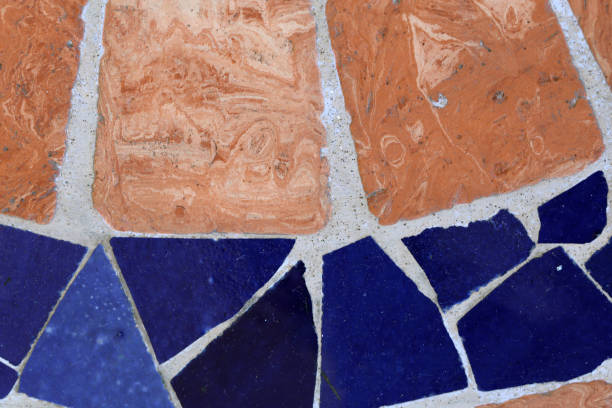 Texture of a Floor Made of Orange & Blue Tiles stock photo