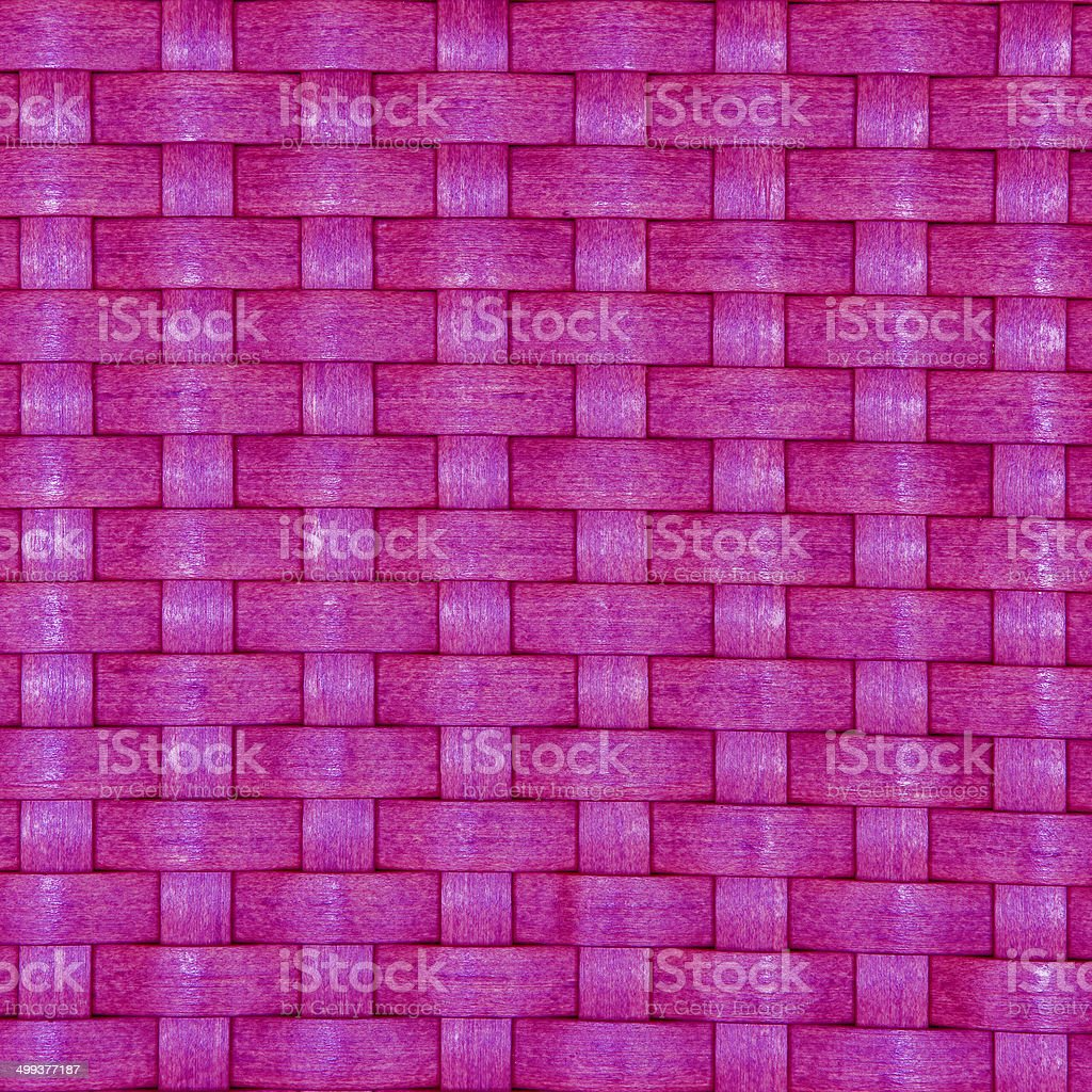 Texture of a pink wicker basket weave
