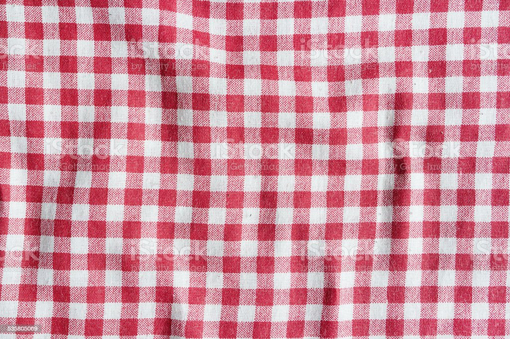 Texture of a red and white checkered tablecloth. stock photo
