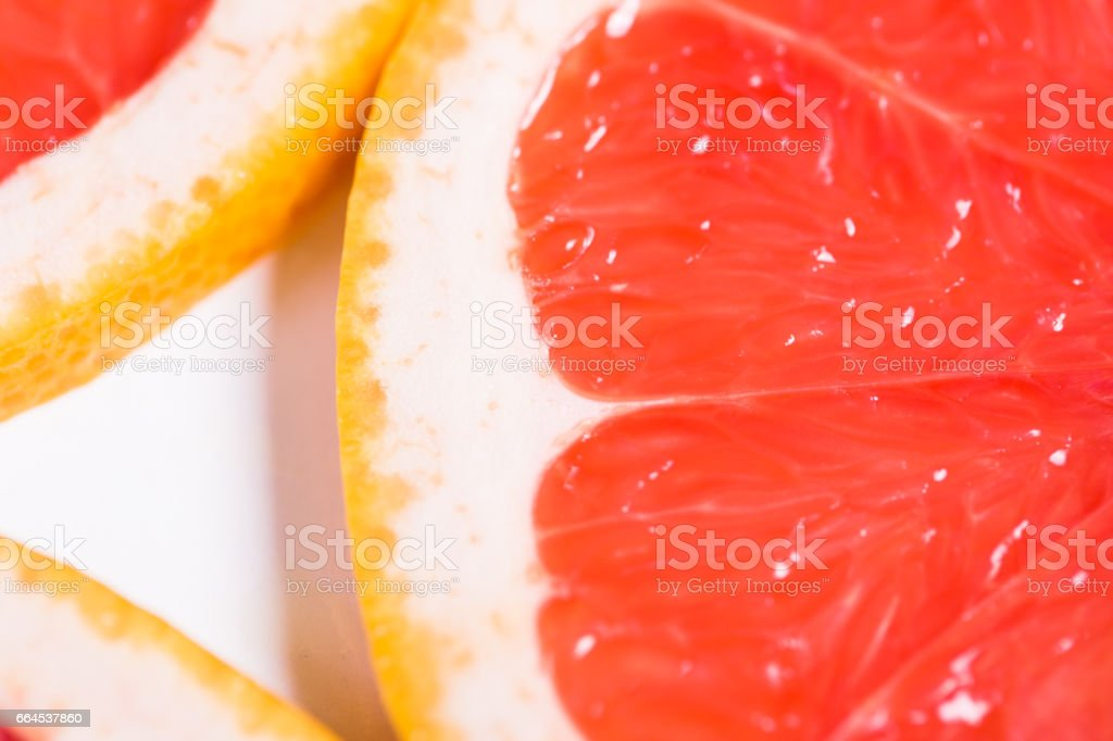 Texture of a ripe grapefruit slice, closeup royalty-free stock photo