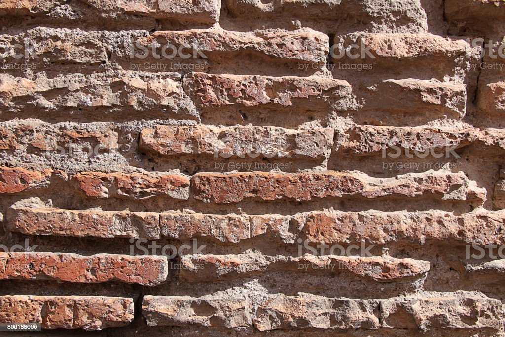 Texture of a very old brick wall stock photo
