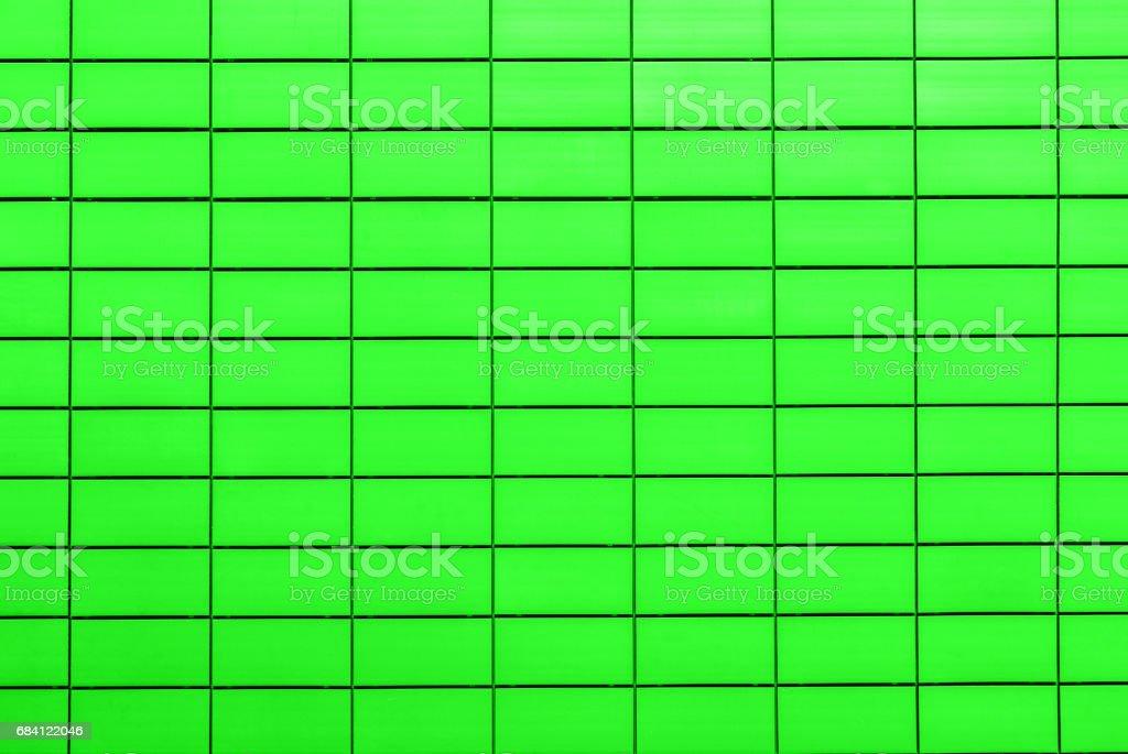 Texture of acid green decorative tiles in form of brick royaltyfri bildbanksbilder