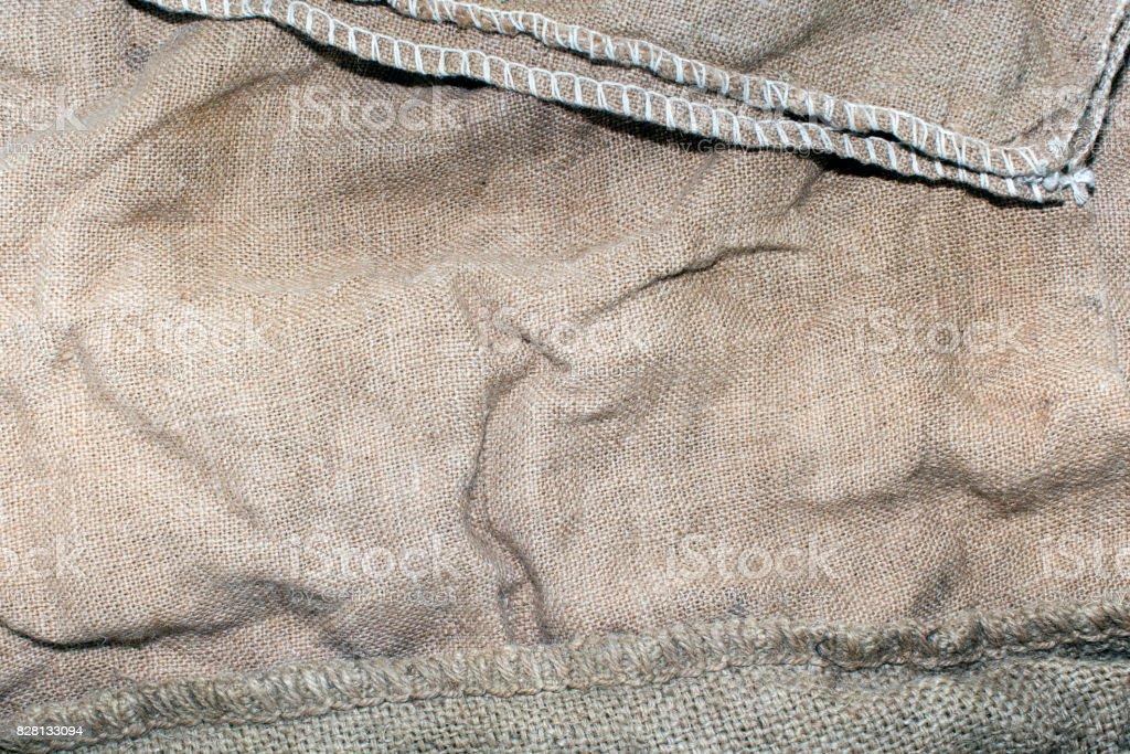Texture of an old dirty potato sack stock photo