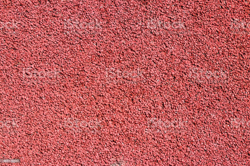 Texture of artificial rubberized coating of sports grounds and stadiums for outdoor use. Red relief texture of the background. zbiór zdjęć royalty-free