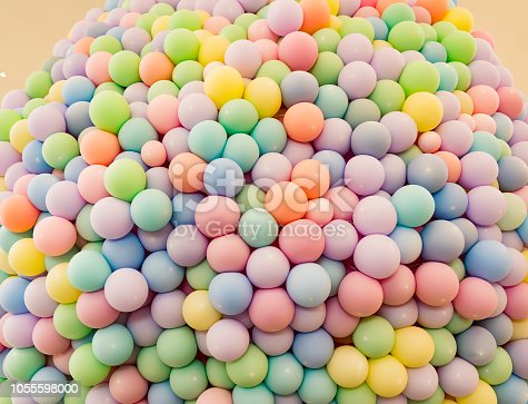 945748362 istock photo Texture of balloons as wall background 1055598000