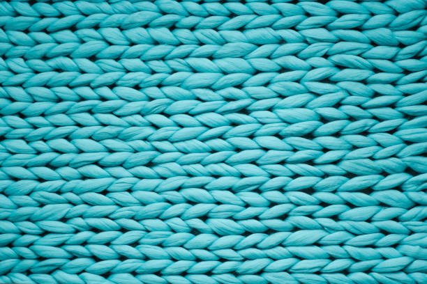 Texture of blue knit blanket. Large knitting. Plaid merino wool. Top view stock photo