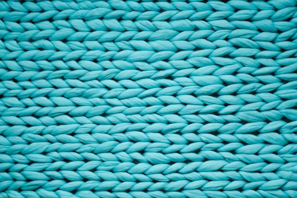 藍色編織毯的質地。大型針織。格子花呢羊毛。頂部視圖 - 針織品 個照片及圖片檔