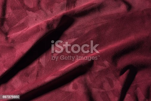 istock Texture of  burgundy crumpled leather close-up background 697375650