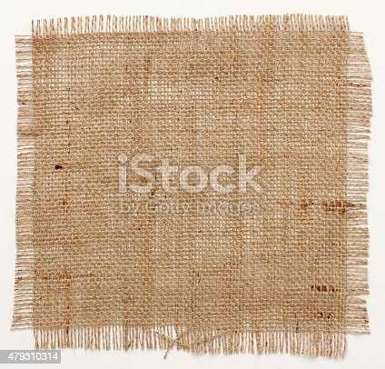 istock texture of Burlap hessian square with frayed edges 479310314