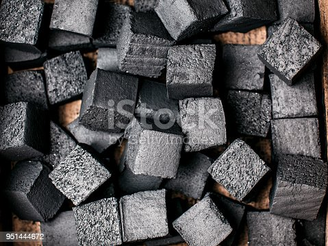 istock Texture of coal for hookah. 951444672