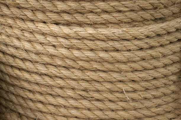 texture of coiled sisal rope. several layers of thick rope as background - sisal stock pictures, royalty-free photos & images