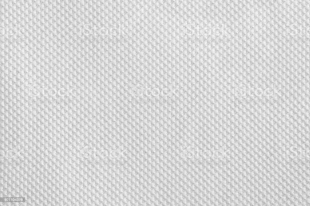 Texture of cool polyester fabric. Background of white textile stock photo