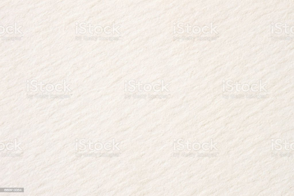 Texture of cream-coloured pastel paper for artwork close-up, light tones. For backdrop, substrate, composition use. With place for your text stock photo