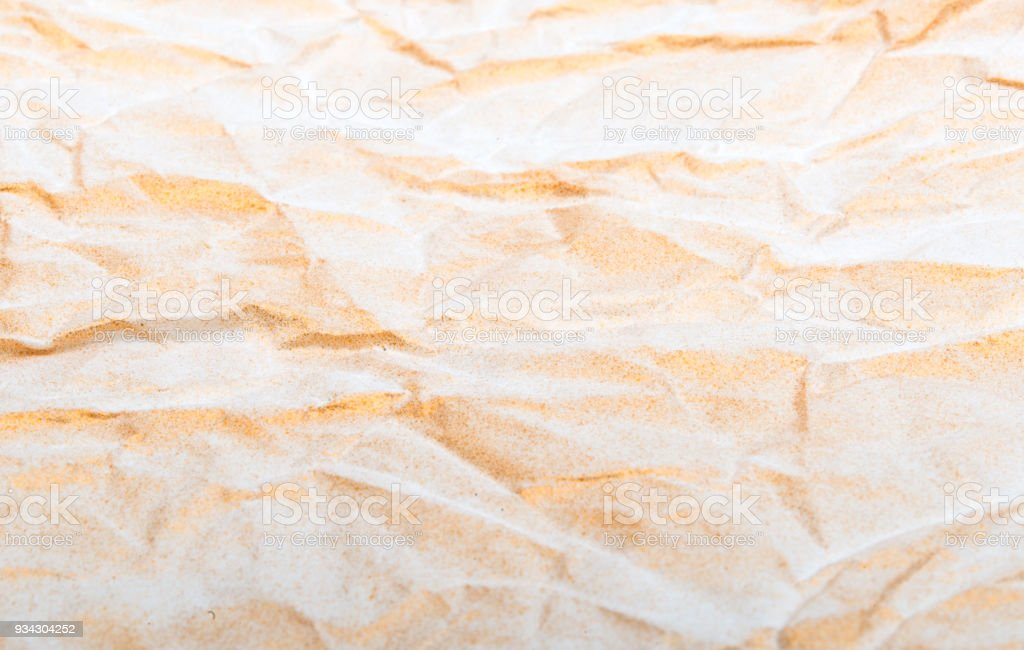 texture of crumpled paper with gilding stock photo