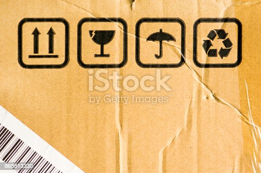 800345184 istock photo Texture of damaged cardboard with signs. 868813330