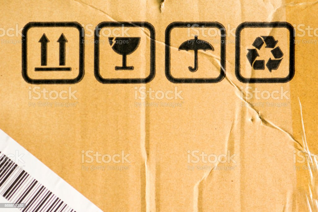 Texture of damaged cardboard with signs. stock photo