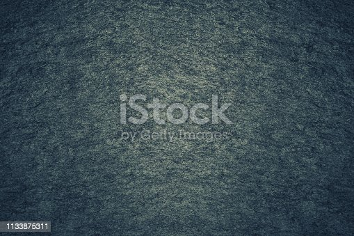 469217930 istock photo Texture of dark gray painted wall. Grunge black stones backdrop. Background ideal for any design 1133875311