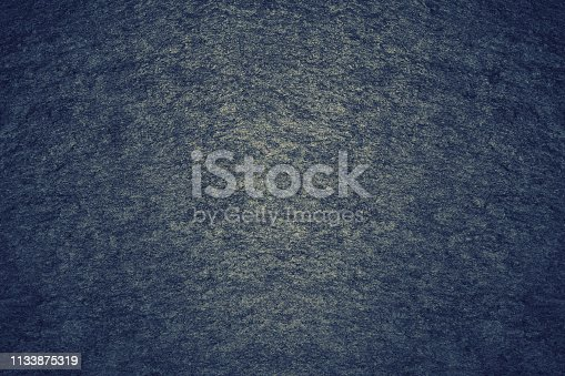 469217930 istock photo Texture of dark gray painted wall. Grunge black stones backdrop. Background ideal for any design 1133875319