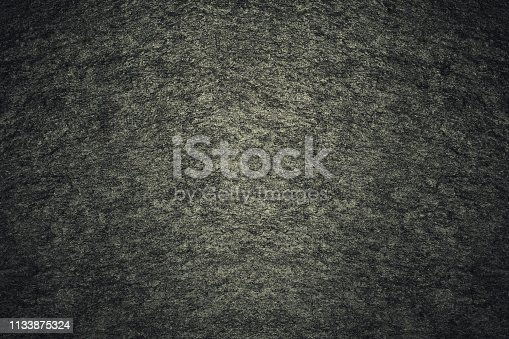 469217930 istock photo Texture of dark gray painted wall. Grunge black stones backdrop. Background ideal for any design 1133875324