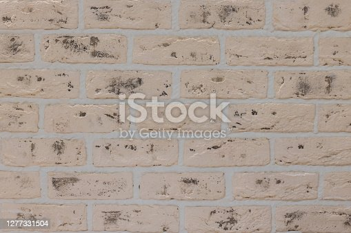 Texture of decorative brick gray wall, background. Blank for the designer.