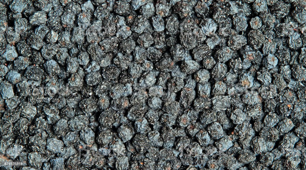 Texture of dried black aronia berries – zdjęcie